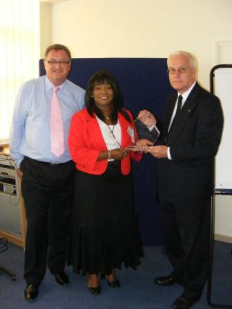 Sandra receiving the Outstanding Contribution Award presented by Ron Simpson CMI Regional Chair (right) with Rob Bennett Regional Manager