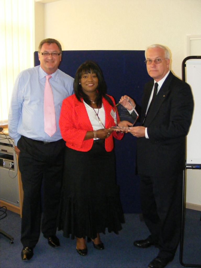 Sandra receiving the CMI Outstanding Contribution Award from Ron Simpson CMI Regional Chair & Rob Bennett Regional Manager